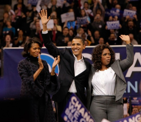 Presidential Candidate Barack Obama is joined by special guest Oprah Winfrey and his wife Michelle Obama during a rally held at the Verizon Wireless Arena in Manchester, New Hampshire on December 9, 2007 in New York City